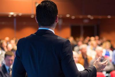 Seminar presenter giving Presentation